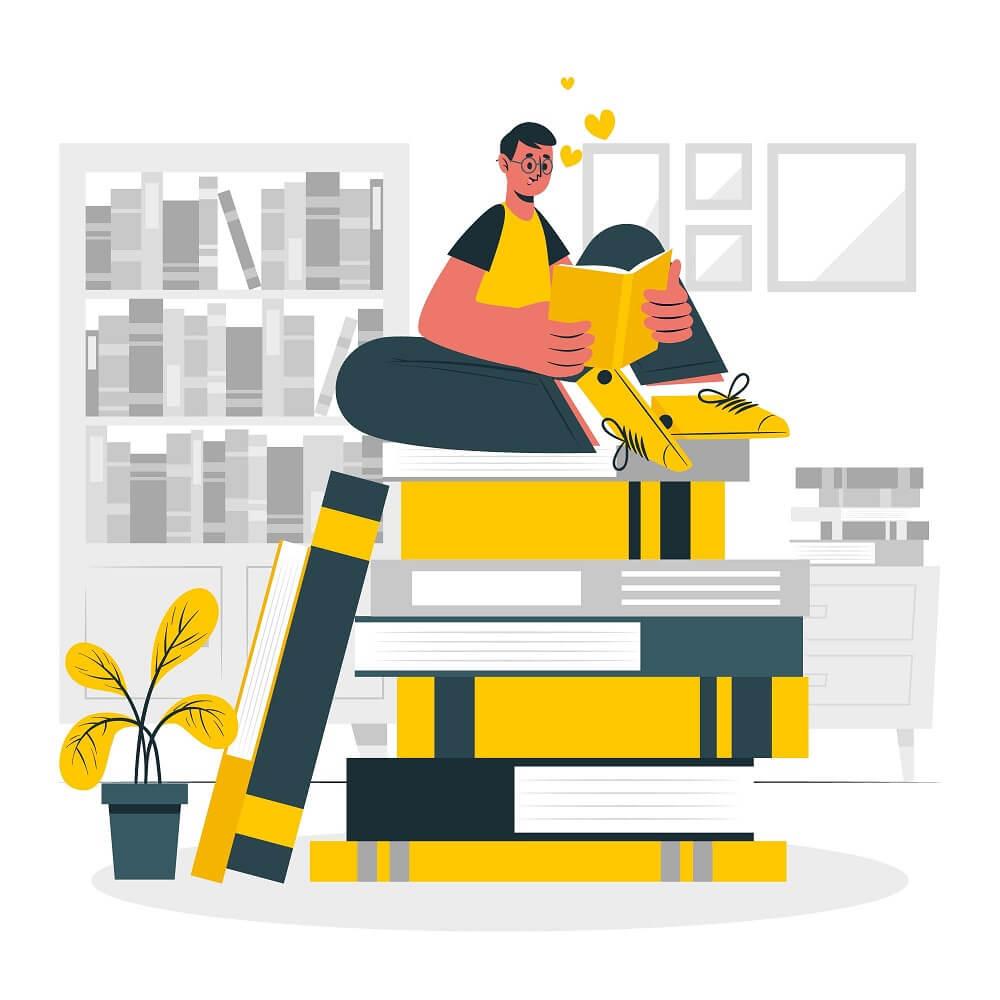 積み重なる本の上で読書している青年