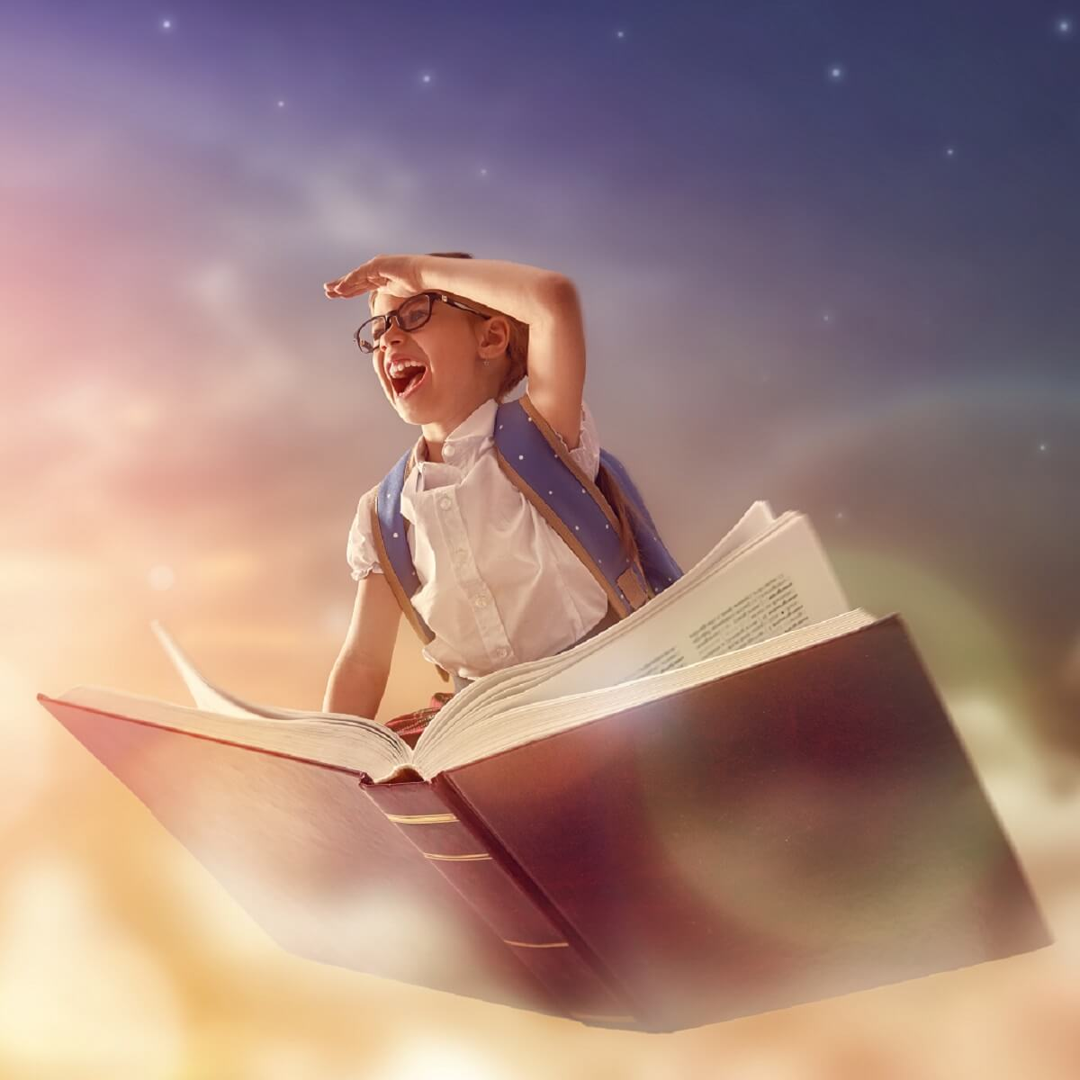 本に乗ってイマジネーションの世界を旅をする子供。