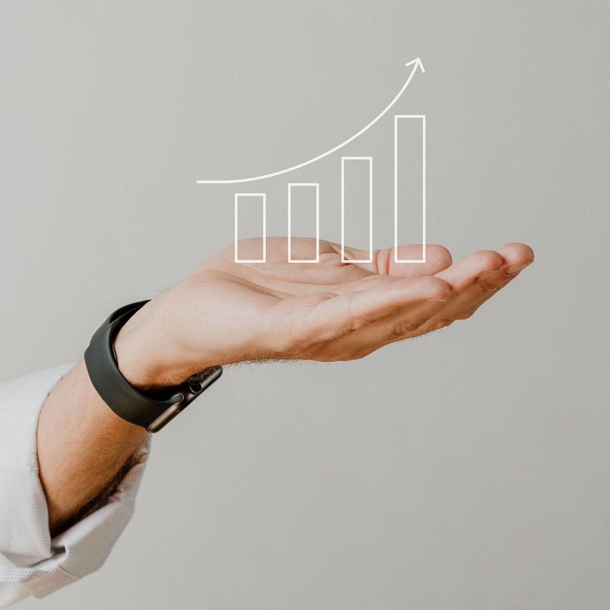 上に向けた手のひらに増加しているグラフを描いた様子。